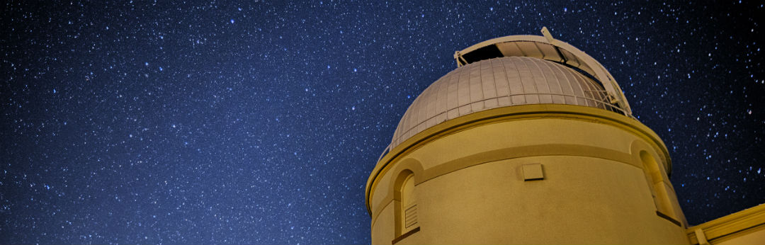An aesthetic view of Lick Observatory's main building, with the 36 inch Great Refractor's dome open.